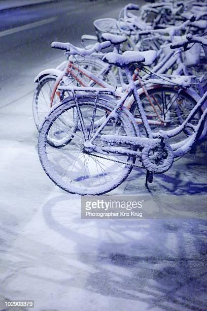 Snow Covered Bikes along street in Copenhagen
