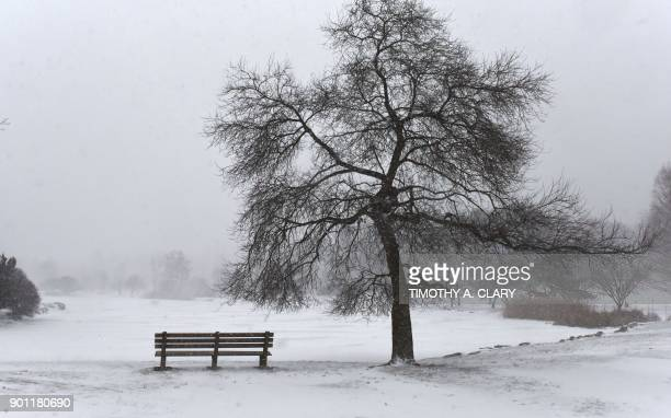 A snow covered Bruce Park is viewed in Greenwich Connecticut on January 4 2018 The US National Weather Service warned that a major winter storm would...