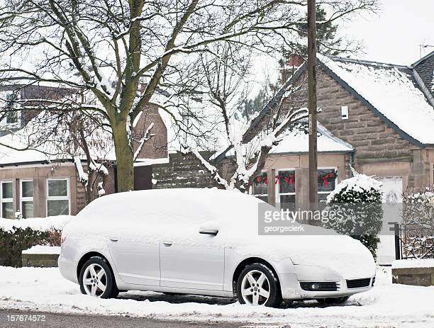 Snow Covered Car on the Street