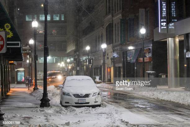 A snow covered car parked downtown during a snow storm early February 13 2017 in Boston Massachusetts Another winter storm has brought heavy snow and...