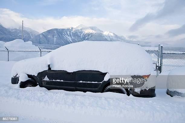 A snow covered car.