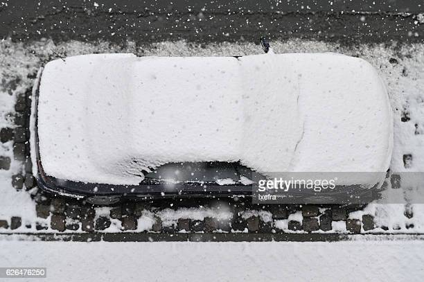 A snow covered car seen from above.