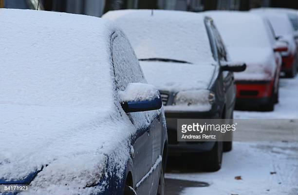Snow covered cars are seen on January 5 2009 in Berlin Germany Germany expects freezing conditions with snow ice and temperatures at 20 degrees below...