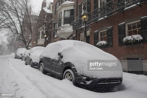 Snow covered cars in the Beacon Hill neighborhood as a winter storm bears down on February 9 2017 in Boston Massachusetts A snowstorm has been...