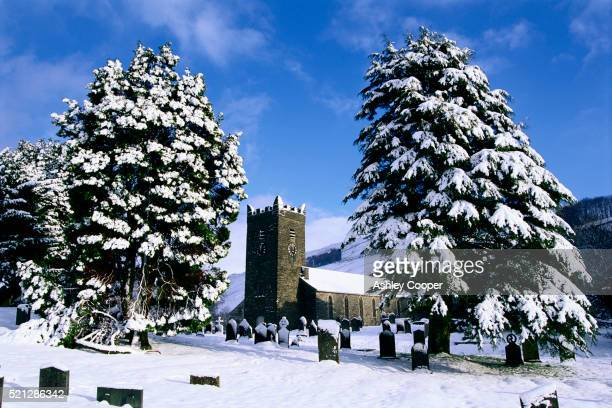 snow covered church and cemetery - church stock pictures, royalty-free photos & images