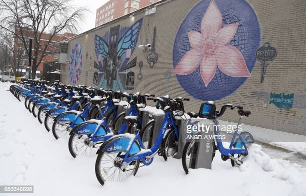 Snow covered Citi bikes sit idle in Brooklyn New York on March 14 2017 Winter Storm Stella unleashed its fury on much of the northeastern United...