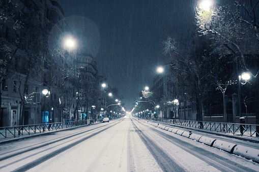 Snow Covered City Street Against Sky At Night - gettyimageskorea