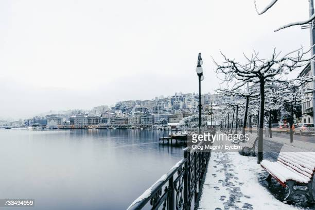 Snow Covered Cityscape Against Sky
