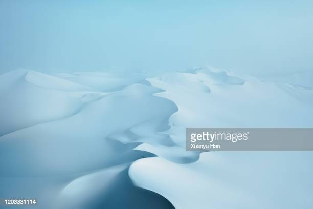 snow covered desert sand dunes in winter - schneebedeckt stock-fotos und bilder