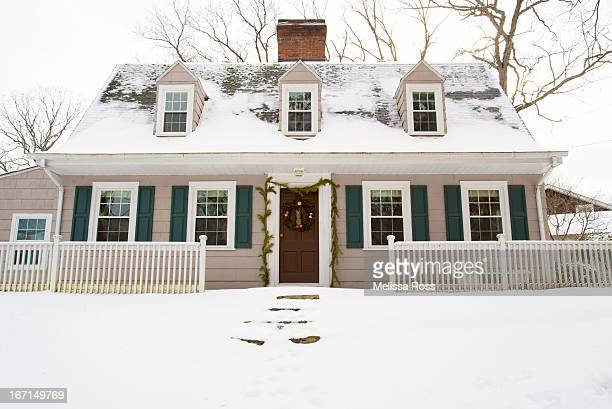 snow covered dutch colonial style home - colonial style stock pictures, royalty-free photos & images