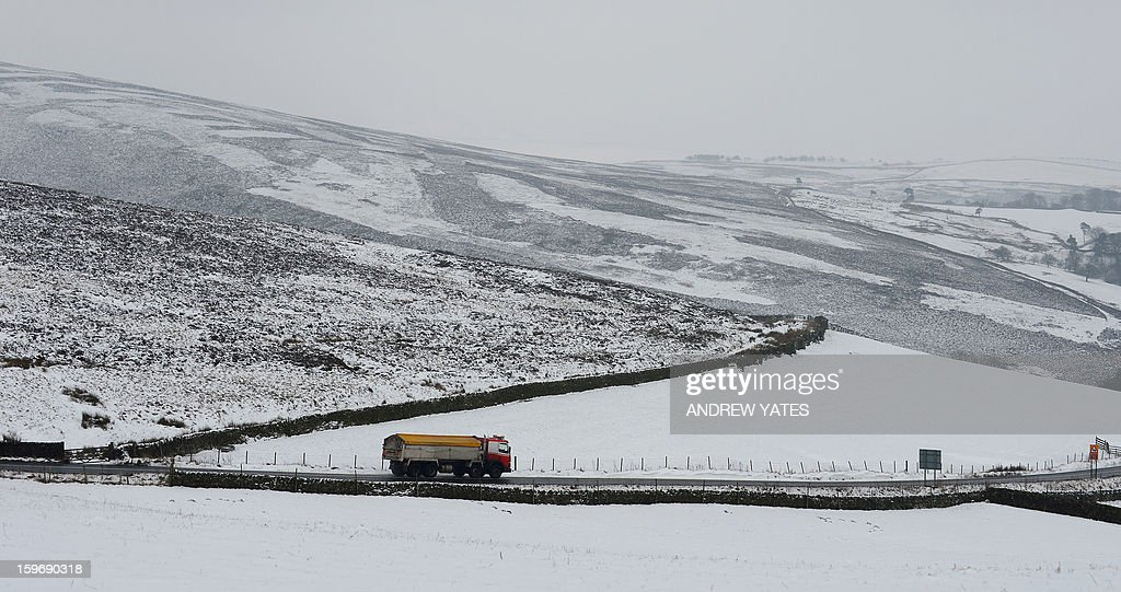 Snow covered fields are pictured on the hills above Hayfield in the Peak district, northern England, on January 18, 2013. Snow swept across Britain on Friday, forcing airports to cancel dozens of flights and more than 2,000 schools to close.