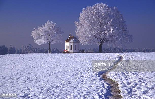 Snow covered footpath to church