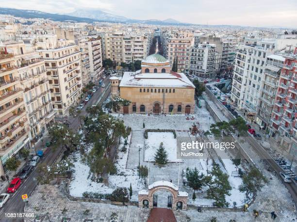 Snow covered Hagia Sophia Church in the city center a UNESCO World Heritage Site Aerial view of the snow covered city of Thessaloniki and its...