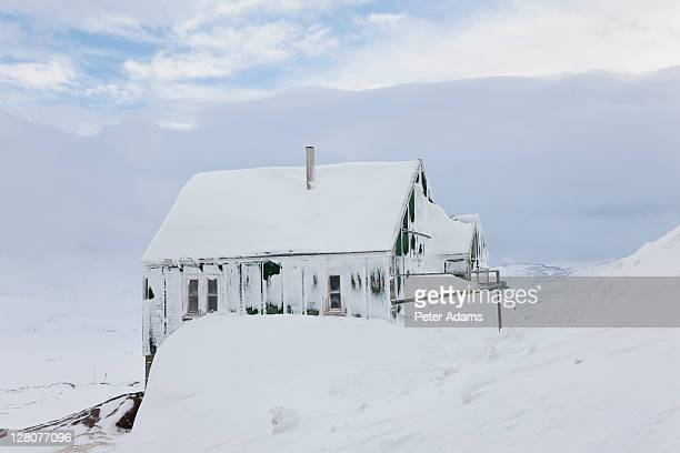 snow covered house, tasiilaq, greenland - peter adams stock pictures, royalty-free photos & images