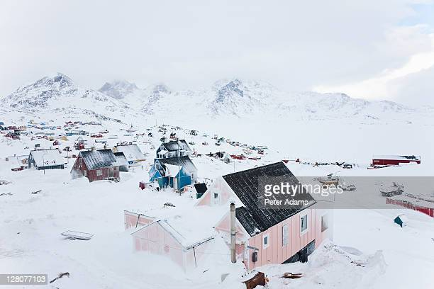 snow covered house, tasiilaq, greenland - east stock pictures, royalty-free photos & images