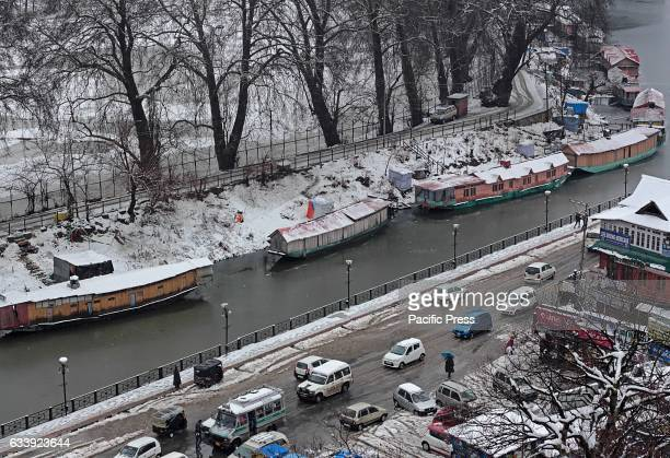 Snow covered houseboats are seen in Dal Lake after fresh snowfall Fresh spell of rain and snow has affected many parts of Jammu and Kashmir and the...