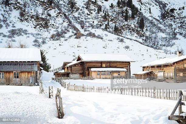 Snow Covered Houses On Landscape