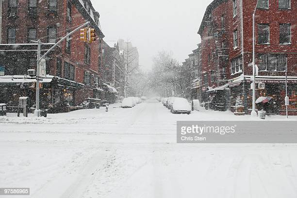 snow covered intersection - blizzard stock pictures, royalty-free photos & images