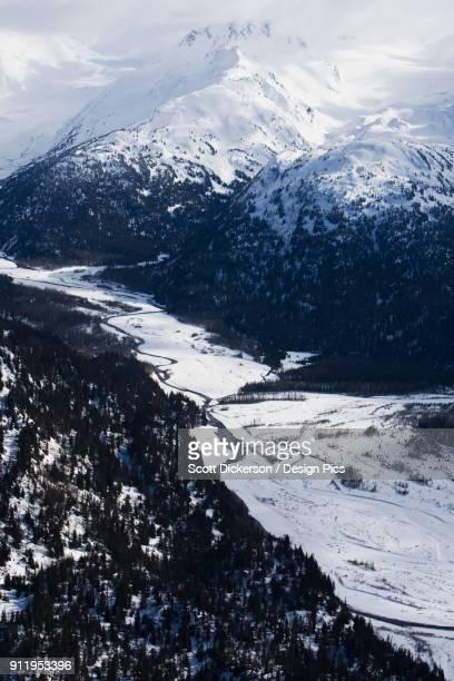 snow covered kenai mountains, kachemak bay state park - kenai mountains stock pictures, royalty-free photos & images