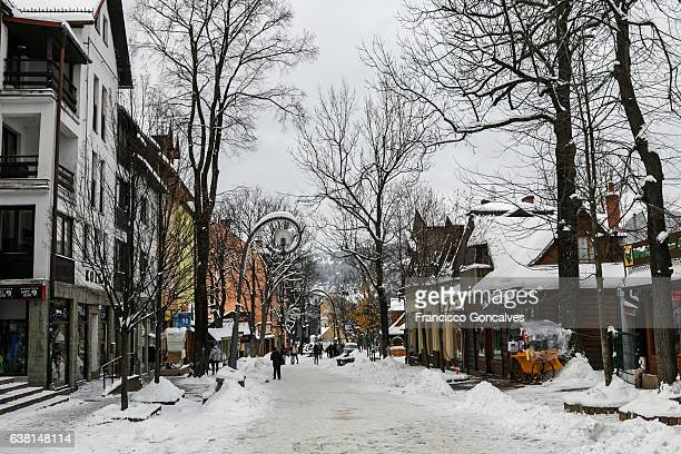 snow covered krupowki street in zakopane, poland - zakopane stock pictures, royalty-free photos & images