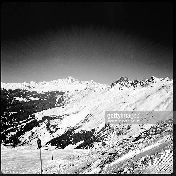snow covered landscape against clear sky - arnault stock pictures, royalty-free photos & images