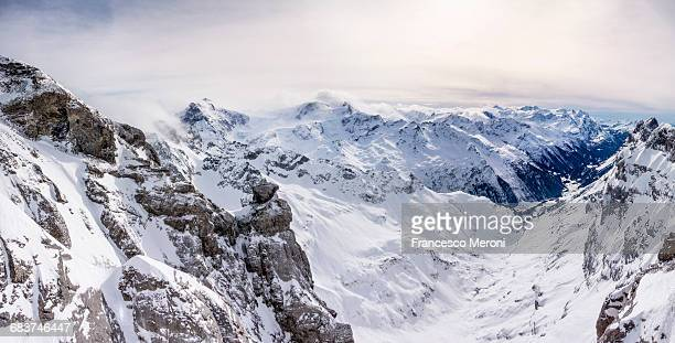 Snow covered landscape and low cloud, Mount Titlis, Switzerland