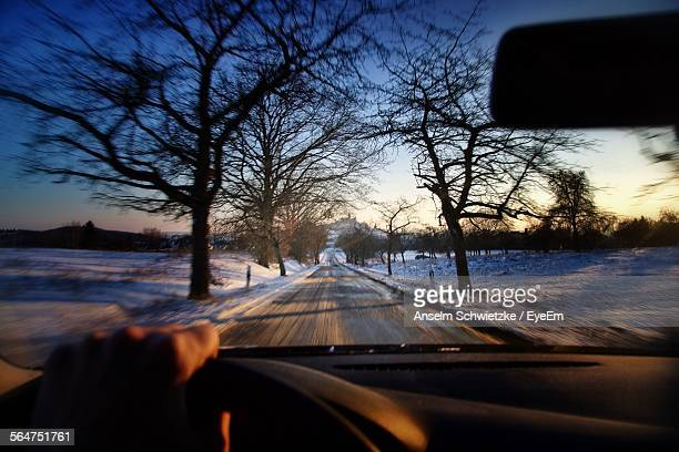 Snow Covered Landscape Viewed Through Car Windshield