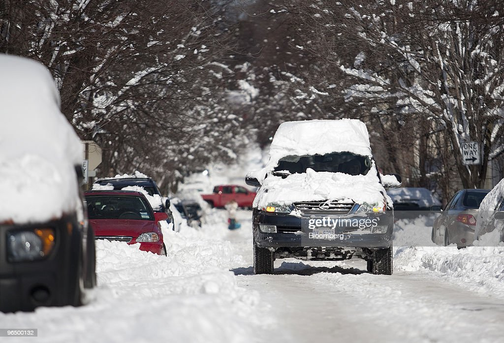 A snow covered Lexus vehicle drives on a street in the Georgetown neighborhood of Washington, D.C., U.S. on Monday, Feb. 8, 2010. A new storm system barreling across the country may bring as much as 12 inches (30 centimeters) of snow to New York, Washington and Baltimore starting late tomorrow, forecasters said. Photographer: Andrew Harrer/Bloomberg via Getty Images