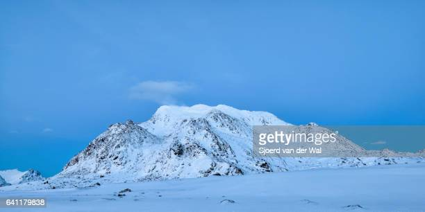 "snow covered mountain after sunset in the lofoten - ""sjoerd van der wal"" stock pictures, royalty-free photos & images"