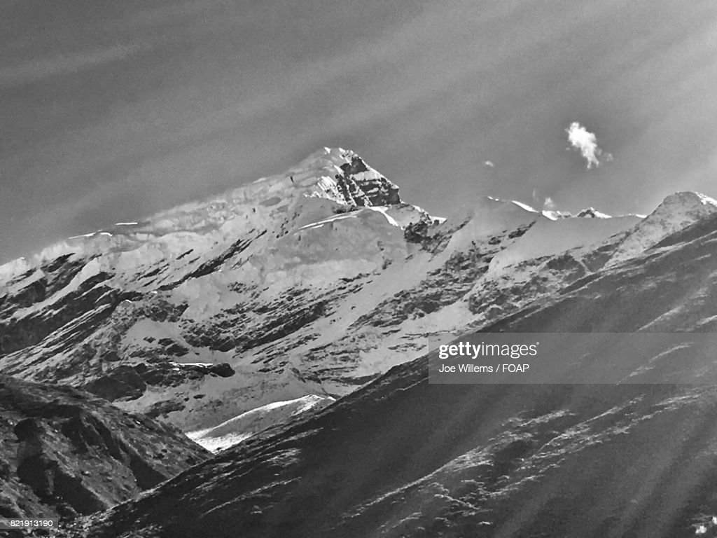 Snow covered mountain against sky : Stock Photo