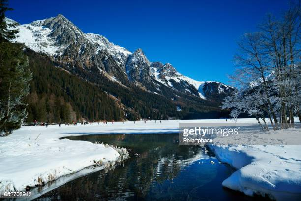 snow covered mountain and lake in scenic dolomite alps landscape