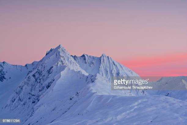 snow covered mountain at sunset, la plagne, france. - mountain range stock pictures, royalty-free photos & images