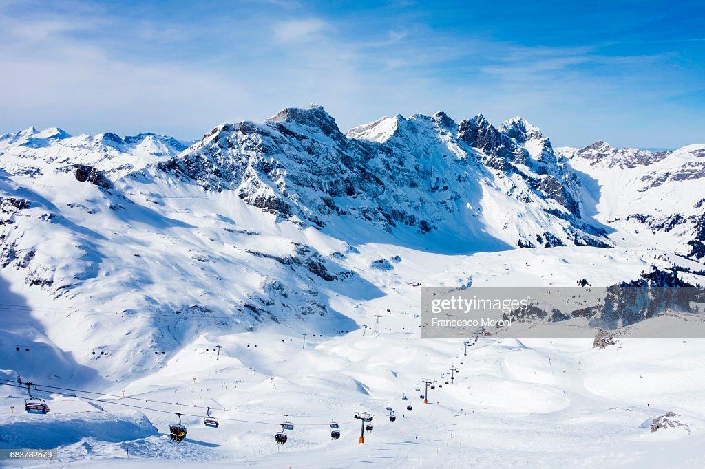 Snow covered mountain landscape and ski lift, Engelberg, Mount Titlis, Switzerland : Stock Photo
