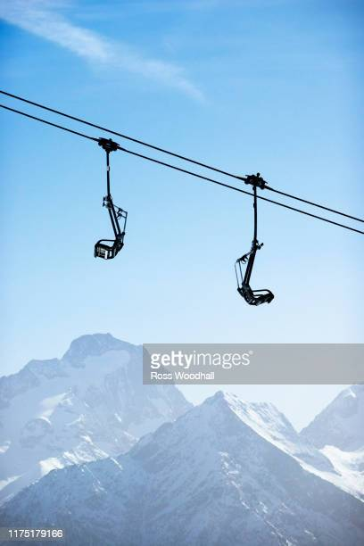 snow covered mountain landscape with ski lift,  alpe-d'huez, rhone-alpes, france - ski lift stock pictures, royalty-free photos & images
