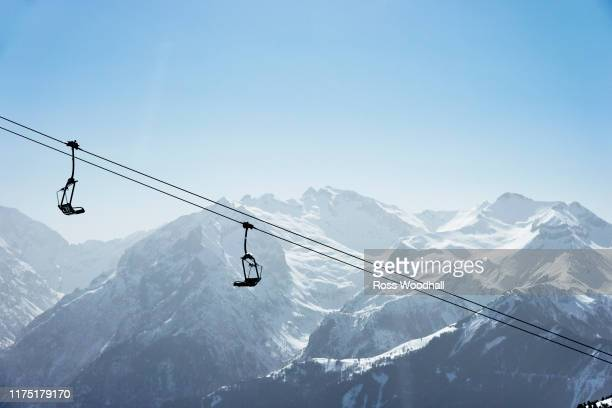 snow covered mountain landscape with ski lift,  alpe-d'huez, rhone-alpes, france - ski resort stock pictures, royalty-free photos & images