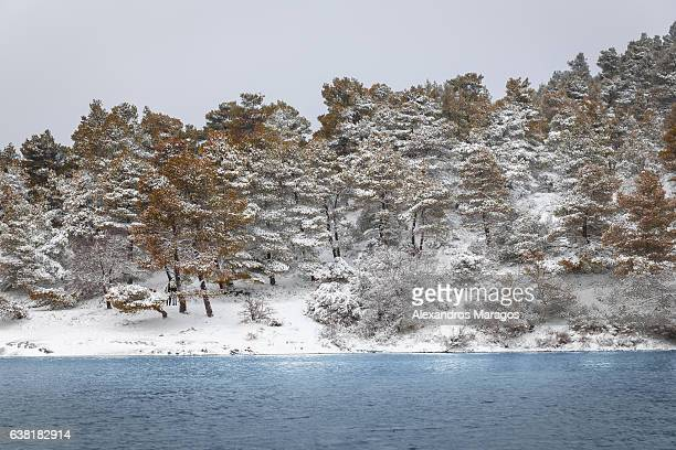 Snow covered mountain over lake Beletsi in Greece