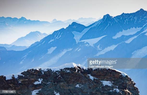 snow covered mountain peaks, monte rosa piedmont, italy - monte rosa foto e immagini stock