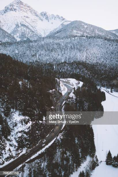 Snow Covered Mountain Road Against Sky