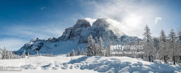 snow covered mountains against sky - snowcapped mountain stock pictures, royalty-free photos & images