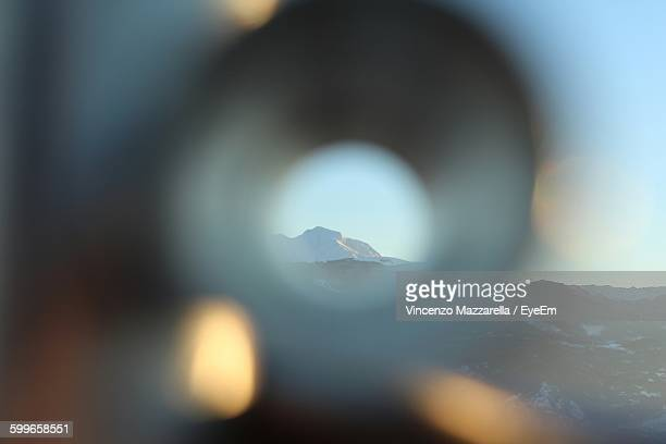 Snow Covered Mountains Seen Through Telescope
