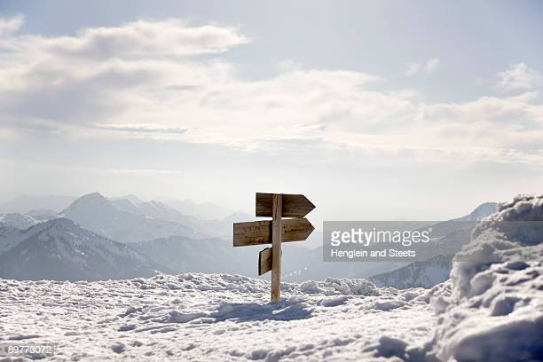 snow covered mountains, way sign - directional sign stock pictures, royalty-free photos & images