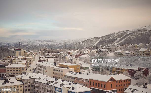 Snow Covered Narvik Against Sky