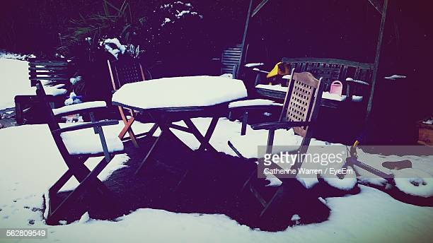 Snow Covered On Empty Table And Chair