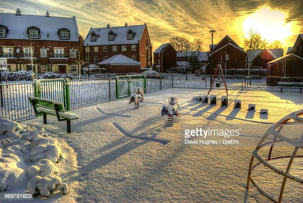 snow covered playground and houses during sunset - york yorkshire stock photos and pictures
