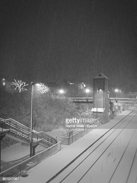 snow covered railroad station at night - rachel wolfe stock pictures, royalty-free photos & images