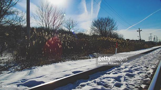 snow covered railroad tracks - howard,_wisconsin stock pictures, royalty-free photos & images