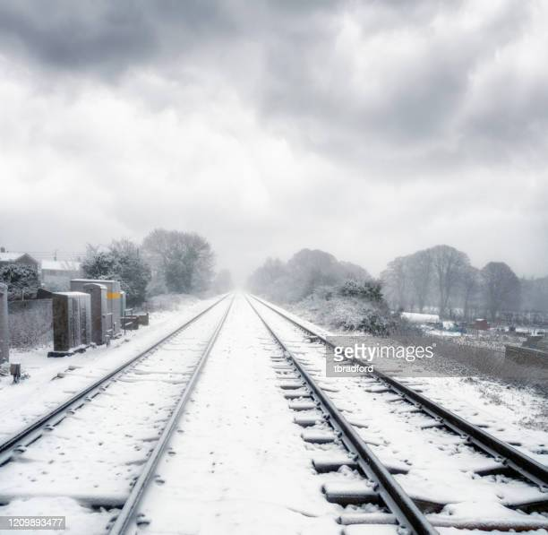 snow covered railway tracks in the uk - deep snow stock pictures, royalty-free photos & images