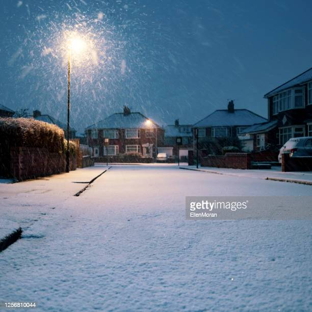 snow covered residential road - night stock pictures, royalty-free photos & images