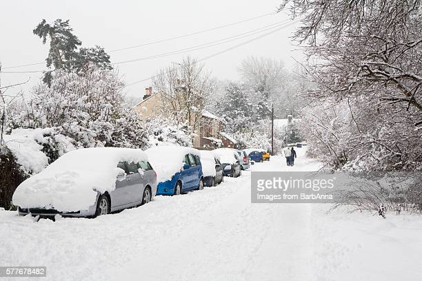 snow covered residential street in godalming, surrey, england, uk - deep snow stock pictures, royalty-free photos & images