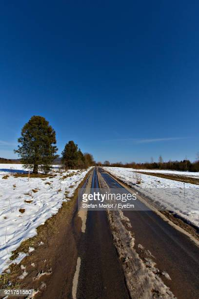 Snow Covered Road Against Clear Blue Sky